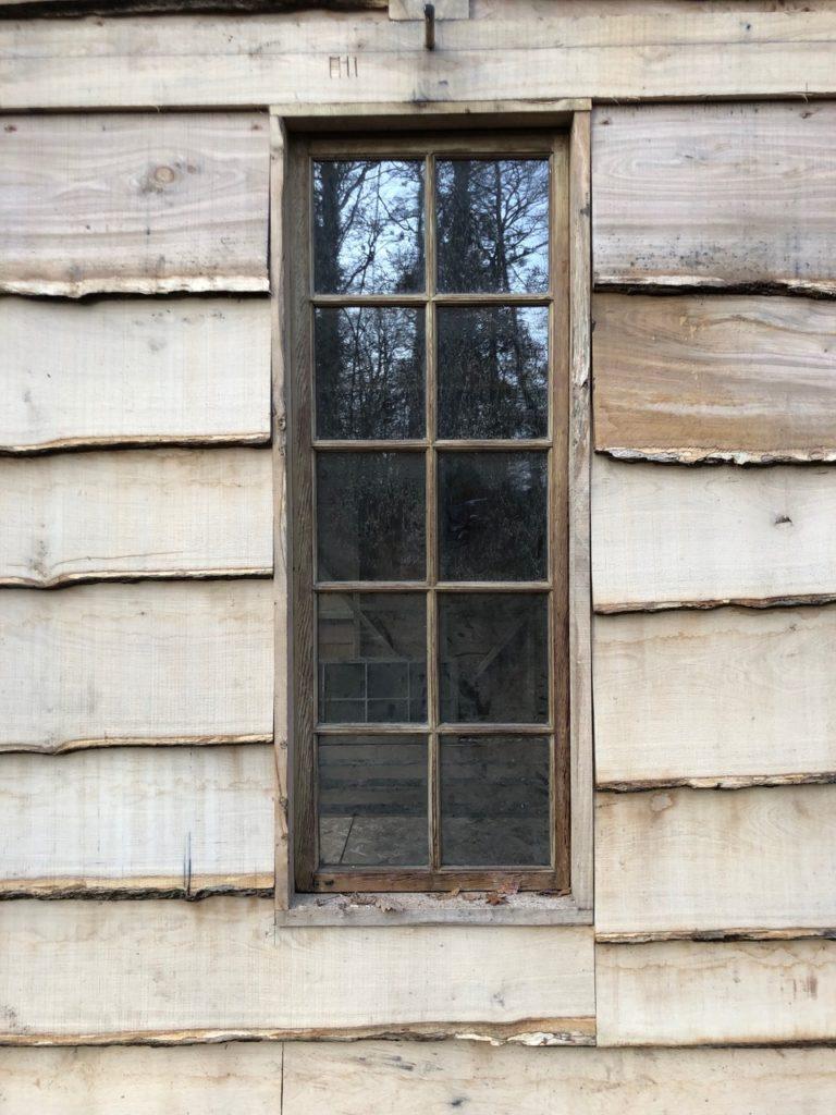 Oak framed woodland cabin reclaimed window.