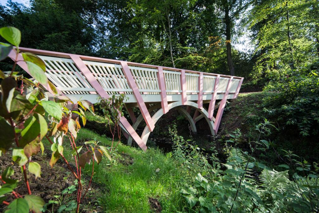 Timber framed bridge with green oak decking.